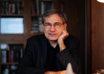 """TO GO WITH AFP STORY BY PHILIPPE ALFROY  Turkish Nobel laureate author Orhan Pamuk poses during an interview at his house in Istanbul on Febuary 2, 2015. World acclaimed Turkish writer Orhan Pamuk has started to work on his new novel featuring Istanbul in his flat overlooking the Bosphorus, Topkapi Palace and the Blue Mosque. Since he was awarded the Nobel Prize in 2006, he's become one of the most vocal critic of the """"climate of fear"""" he said conservative and Islamic Turkish President Recep Tayyip Erdogan imposed on Turkey. AFP PHOTO/OZAN KOSE        (Photo credit should read OZAN KOSE/AFP/Getty Images)"""