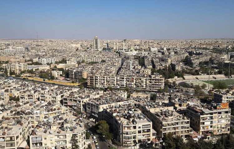 In this photo taken on Friday, Sept. 27, 2019, A general view shows the old city of Aleppo with the ancient Citadel on the background, Syria. More than eight years of fighting has left many sections of Aleppo destroyed, and now authorities are pleading for international help to fund restoration of the ancient city. (AP Photo/Alexander Zemlianichenko)
