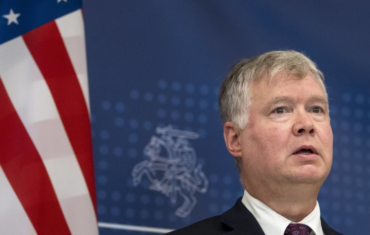 U.S. Deputy Secretary of State Stephen Biegun talks with the press, after meeting with Lithuania's Foreign Minister Linas Linkevicius in Vilnius, Lithuania, Monday, Aug. 24, 2020. (AP Photo/Mindaugas Kulbis)