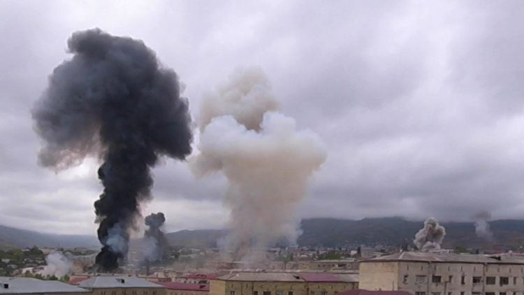 Smoke billows above the buildings during a military conflict over the breakaway region of Nagorno-Karabakh, in Stepanakert October 4, 2020 in this still image taken from video obtained on October 6, 2020.  Bars Media Documentary Film Studio via REUTERS   THIS IMAGE HAS BEEN SUPPLIED BY A THIRD PARTY. MANDATORY CREDIT