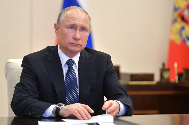 April 7, 2020. - Russia, Moscow Region, Novo-Ogaryovo. - Russian President Vladimir Putin during a video conference meeting at the Novo-Ogaryovo residence with experts on the current coronavirus situation and the measures implemented to contain the spread of the COVID-19 infection.